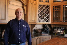 """<div class=""""source"""">Doug Ponder</div><div class=""""image-desc"""">Walters Cabinets is a custom cabinet shop located on 4405 Old Elizabethtown Road in Hodgenville. Owner Robbie Walters is shown standing in front of a cabinet display in the showroom. </div><div class=""""buy-pic""""><a href=""""/photo_select/45016"""">Buy this photo</a></div>"""