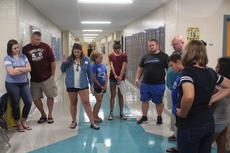 "<div class=""source"">doug ponder</div><div class=""image-desc"">Celina Leggiere from Tuscaloosa, Alabama is pictured praying in the prayer circle formed at the LaRue County Middle School. Leggiere was in LaRue County visiting family friends and knows two girls who will be attending LaRue County Middle School this year. </div><div class=""buy-pic""><a href=""/photo_select/60335"">Buy this photo</a></div>"