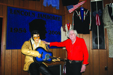 "<div class=""source"">Submitted Photo</div><div class=""image-desc"">Joel Ray poses with Elvis at the Jamboree. </div><div class=""buy-pic""><a href=""/photo_select/55936"">Buy this photo</a></div>"
