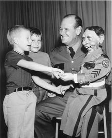"""<div class=""""source"""">Submitted</div><div class=""""image-desc"""">Kentucky State Police Lt. Lee Allen Estes entertained both children and adults with safety themed magic tricks and ventriloquism throughout the state during the 1940s, 50s and 60s.     </div><div class=""""buy-pic""""><a href=""""/photo_select/34841"""">Buy this photo</a></div>"""