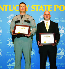 """<div class=""""source"""">Submitted photo</div><div class=""""image-desc"""">Senior Trooper Michael Garyantes, left, and Detective Jason Propes were honored May 14.</div><div class=""""buy-pic""""><a href=""""/photo_select/35501"""">Buy this photo</a></div>"""