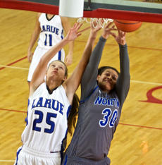 "<div class=""source"">PETER W. ZUBATY/Landmark News Service</div><div class=""image-desc"">LaRue County's Allison Evans and North Hardin's Jenna Spencer battle for a rebound underneath.</div><div class=""buy-pic""><a href=""/photo_select/33739"">Buy this photo</a></div>"
