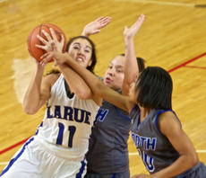 "<div class=""source"">PETER W. ZUBATY/Landmark News Service</div><div class=""image-desc"">LaRue County's Alexis Brewer gets whacked across the arm by North Hardin's Tamiah Stanford on the way to a bucket and the bonus. Brewer dominated the game with 44 points and eight rebounds.</div><div class=""buy-pic""><a href=""/photo_select/33740"">Buy this photo</a></div>"