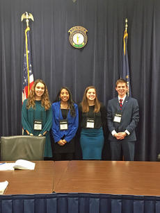 """<div class=""""source""""></div><div class=""""image-desc"""">LaRue County Middle School delegates Macy Stillwell, second from left, and Samantha Perkins, third from left, are pictured with unidentified middle school Kentucky Youth Assembly's Lieutenant Governor and the Lieutenant Governor's clerk. Perkins and Stillwell sponsored a bill that passed both houses and was signed into law by the Lieutenant Governor. </div><div class=""""buy-pic""""><a href=""""/photo_select/61763"""">Buy this photo</a></div>"""