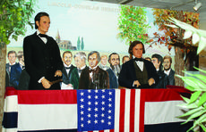 """<div class=""""source"""">Linda Ireland</div><div class=""""image-desc"""">The Lincoln-Douglas debate is one of 12 scenes in the Lincoln Museum in Hodgenville. Artist Lois Wimsett painted familiar faces from the community in the crowd behind Abraham Lincoln and Stephen Douglas. From left, Randy Murray, Fabian Howard, Milburn Howard (behind Lincoln), Francis Milburn 'Boogie' Howard (behind Lincoln, deceased) Buddy Terry, Bobby Williams (deceased), Larry Gream, Julian Howard (deceased), Edwin Stanton (only historical figure, Lincoln's Secretary of War, deceased), Eddie Wimsett (deceased), Sam Edlin (behind Douglas, deceased), Damon Osbourne (also behind Douglas), Jeri Burks and Alex LaRue.</div><div class=""""buy-pic""""><a href=""""/photo_select/33530"""">Buy this photo</a></div>"""
