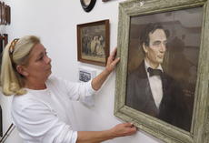 "<div class=""source"">Ron Benningfield</div><div class=""image-desc"">Iris LaRue, Lincoln Museum director, studies one of the pieces of a collection of Lincoln-era art donated to the museum.</div><div class=""buy-pic""><a href=""/photo_select/45014"">Buy this photo</a></div>"