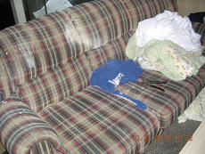 """<div class=""""source""""></div><div class=""""image-desc"""">The couch, where Joseph Gordon White was sitting when a one-step methamphetamine lab allegedly exploded, shows a white powder outlining a body.</div><div class=""""buy-pic""""></div>"""