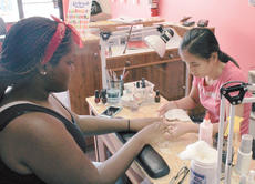 "<div class=""source"">Photo by Vanessa Hurst</div><div class=""image-desc"">Helen Cheang gives a customer a manicure.</div><div class=""buy-pic""><a href=""/photo_select/42552"">Buy this photo</a></div>"
