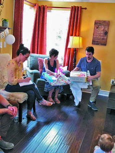 """<div class=""""source""""></div><div class=""""image-desc"""">My wife and I opening gifts at our baby shower. </div><div class=""""buy-pic""""><a href=""""/photo_select/63865"""">Buy this photo</a></div>"""