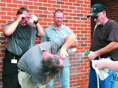 "<div class=""source"">Candis Carpenter</div><div class=""image-desc"">Employees of the LaRue County Detention Center received training on use of pepper spray Monday. To be certified in its usage, the employees had to receive a shot of pepper spray to the face. From left, Adam Puckett, Ricky Herron, Shawn Elmore and James Ma</div><div class=""buy-pic""><a href=""/photo_select/5310"">Buy this photo</a></div>"