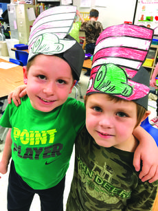 """<div class=""""source""""> submitted photo</div><div class=""""image-desc"""">Mrs. Tharp and Ms. Carol's kindergarten class at Hodgenville Elementary School celebrated Dr. Seuss week on February 26 through March 2. The class celebrated by wearing green clothes, cooking and eating green eggs and ham, and making Dr. Seuss hats. Pictured are Hunter Hill and Colton Hymel. </div><div class=""""buy-pic""""><a href=""""/photo_select/58049"""">Buy this photo</a></div>"""