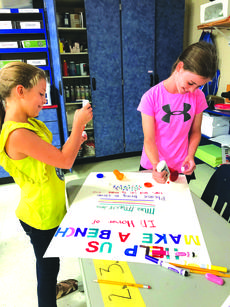 "<div class=""source"">Submitted photo</div><div class=""image-desc"">Fifth grader Ava Warren and fourth grader Brooklynn Skaggs put the finishing touches on one of the posters promoting the cap and lid collection.</div><div class=""buy-pic""><a href=""/photo_select/60804"">Buy this photo</a></div>"