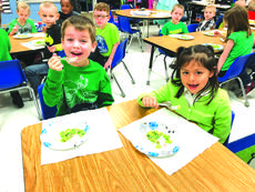 """<div class=""""source""""> submitted photo</div><div class=""""image-desc"""">Henry Allen and Isabella Salazar said, """"We like green Eggs and Ham!"""" Their class celebrated Dr. Seuss week on February 26 through March 2. The two students are pictured eating green eggs and ham on Tuesday, February 27. </div><div class=""""buy-pic""""><a href=""""/photo_select/58050"""">Buy this photo</a></div>"""