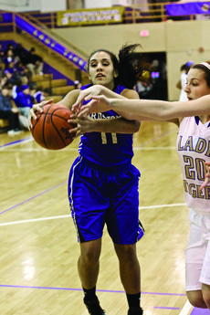 """<div class=""""source"""">Peter W. Zubaty/The Kentucky Standard</div><div class=""""image-desc"""">All-State player Alexis Brewer transferred to Bardstown High School for her senior season after helping lead LaRue County's Lady Hawks to the region finals last season. Above, Brewer grabbed a rebound during the Tigers' Purple Madness preview. </div><div class=""""buy-pic""""><a href=""""/photo_select/40288"""">Buy this photo</a></div>"""