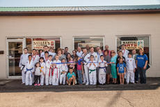 """<div class=""""source"""">Melanie Wells</div><div class=""""image-desc"""">A large crowd gathered for the LaRue County Chamber of Commerce ribbon cutting ceremony for the new location of Sallee's Family Taekwondo. Pictured with owner Randal Sallee, (middle)  is his wife, Lisa Sallee; daughter, Kayla Sallee and grandchildren Izabella Sallee, Izaiah Sallee and Amelia Doty, along with many students and instructors of the center. Also attending was Nina Cundiff, Pam Stephens, Chamber Executive Director Krista Levee, Dean Henderson, Chamber President Allison Shepherd, Alex LaRue, Magistrate Tony Stewart, and a host of other friends and family. </div><div class=""""buy-pic""""><a href=""""/photo_select/43667"""">Buy this photo</a></div>"""