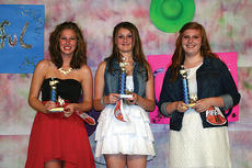 """<div class=""""source"""">Rebecca Roscoe</div><div class=""""image-desc"""">Sarah Casewell placed third, Toni Boyles placed second, and Kailie Gary won the Coca-Cola Classic talent show at the LaRue County Fair.</div><div class=""""buy-pic""""></div>"""