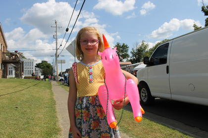 Evelyn Ann Holt shows off her balloon prize at the 2017 Rolling Fork Iron Horse Festival.