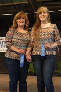 Peggy Webb and daughter April Webb, of Magnolia were this year's winners of the Parent/Child Lookalike contest held Thursday night at the fair. Not only do they look alike, but they enjoy many of the same hobbies, such as painting, drawing, cooking and baking.