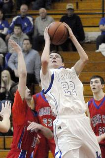 LaRue County's Micah Wiseman goes up for shot from under the basket Monday night in 5th Region Tournament action against Adair County.