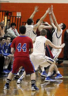 LaRue County's Kody Key, left, Dustin Coulter and Tyler Howell surround Adair County's Chance Melton as he looks to pass Monday night.