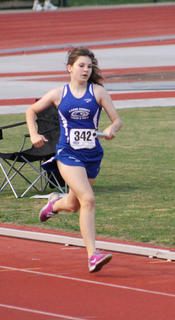 Natalie Mullins running in the 4X400 during the State Track Meet in May at UofL.
