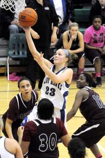 LaRue County's Ivy Brown goes in for a layup through the Marion County defense Tuesday night.