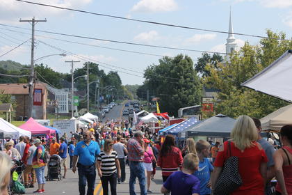 Booths and vendors line Ceneter Street in New Haven Saturday for the 2017 Rolling fork Iron Horse Festival.