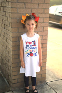 HES Kindergartner Ellie Grace poses for her first day of school picture at Hodgenville Elementary School.