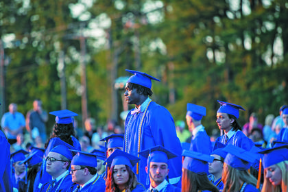 Students who plan to serve in the armed forces were asked to stand so they could be recognized at the graduation ceremony.