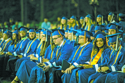 The graduation ceremony was coming to an end as the sun set. The class of 2019 is pictured reflected on the words of their fellow classmates and superiors.