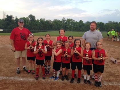 The 9U Reds are Emma Stillwell, Brenna Southwood, EmmaLeigh Thompson, Shelby Cooper, Bailey Brown, Hannah Boggs, Abby Hall, Lilli Gibson, Kirsten Goodwin and Ella Thomas. Coaches are Phillip Hall and Dewayne Gibson.