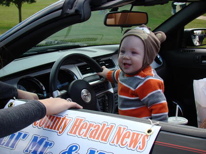 Crayton Thompson rode in the parade. Crayton is the Lil Mr. Sweetheart for The LaRue County Herald News.
