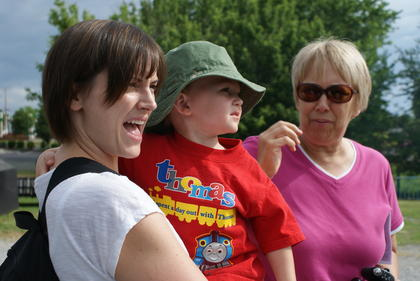 Amanda Coffman and her son, Aiden, 2, of Hustonville, waited for their turn to board Thomas the Tank Engine Saturday at the Kentucky Railway Museum. Grandmother Connie Fowler of Stanford is at left.