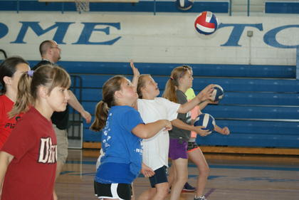 Olivia Bingham, Addie Ann Cundiff and Samantha Martin lined up for a drill at the volleyball clinic.