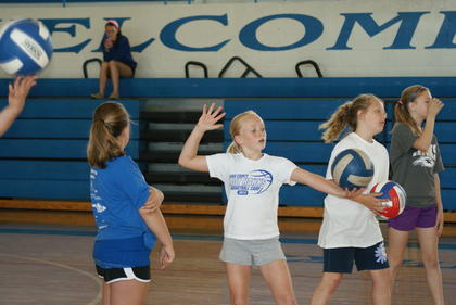 Katelyn Eads worked on her form during a drill at the volleyball clinic.
