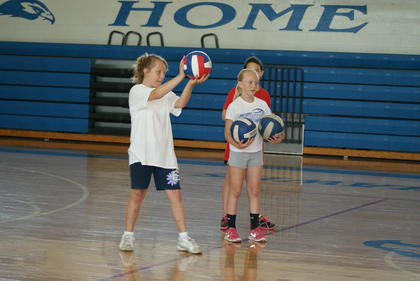 Addie Cundiff, left, and Katelyn Eads participated in a drill at the volleyball clinic.