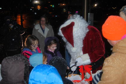 Santa handed out candy canes to the children at Christmas on the Square.