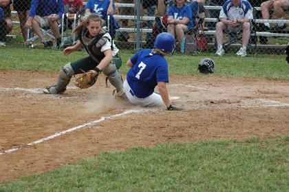 Brigitte Skaggs scores in the top of the fourth inning to give the Lady Hawks an 8-4 lead in the district final