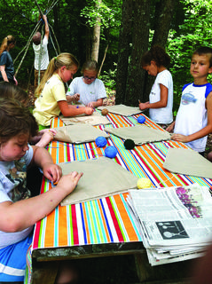 Children at Earth Camp completed a craft on Native American Day. The campers used their imagination to create a mat out of animal hide.