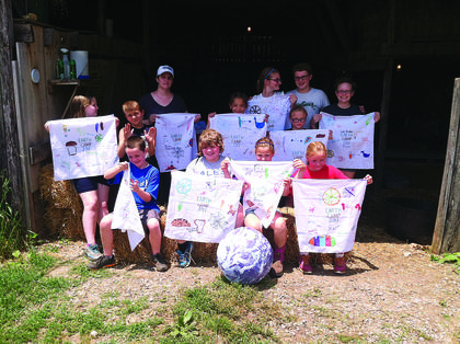 Children who attended Earth Camp at Plowshares Farm Center for Education and Spirituality are front from left, Patrick Butterworth, Abi Gibson, Ryan Brooke Puckett, Monica Ronkainen; middle, Helen Anderson, Heath Thompson, Maleah English, Emily Caffee, Leah Christner; back,  Julie Christner, Rebecca Christner and Jonah Christner. Campers enjoyed learning and playing on the farm as they explored connections to the earth through the lives of animals, prehistoric people, Native Americans, European settlers and modern day people.