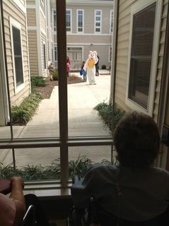Resident Emma Childress watched children walking with the Easter Bunny.