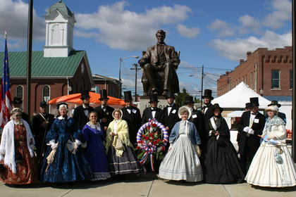 Presenters lined in front of the Lincoln statue