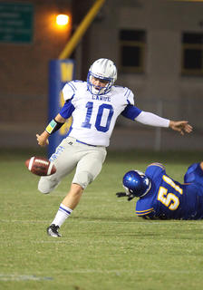 Koy Lindsey punts the ball for the Hawks against Washington County Saturday.