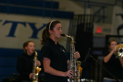 Ashley Whitaker performed a solo on alto saxophone during Thursday's performance.