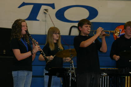 Katelyn Ashford, clarinet; Darian White, percussion; Trevor Mather, trumpet; and Charlie Larimore, percussion, played for a crowd of parents and community supporters Thursday.