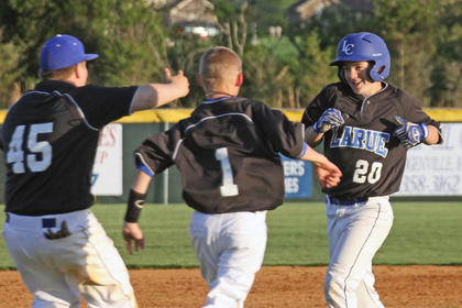 Chase Puyear #45, Tristan Waddle #1, congratulate Caleb Heady #20 on a good play.