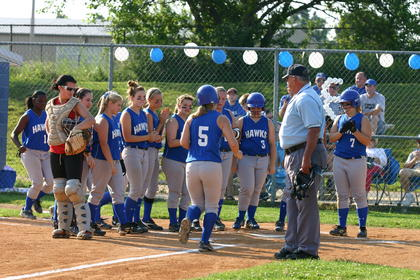 The Lady Hawks congratulate freshman Tristian Cruse on her out-of-the-park homerun.