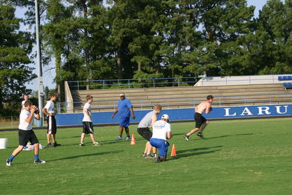 The LaRue County Hawks participate in their last workout before the summer's dead period. Practice resumes on July 15.