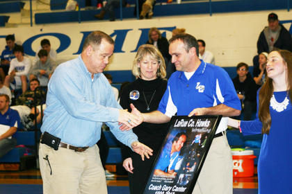 LCHS principal Paul Mullins congratulates Gary Canter on his career.