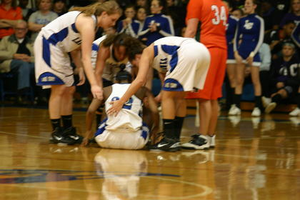 Junior Shana Zajdel is helped to her feet by her teammates